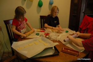 Kids rolling out the sugar cookies.